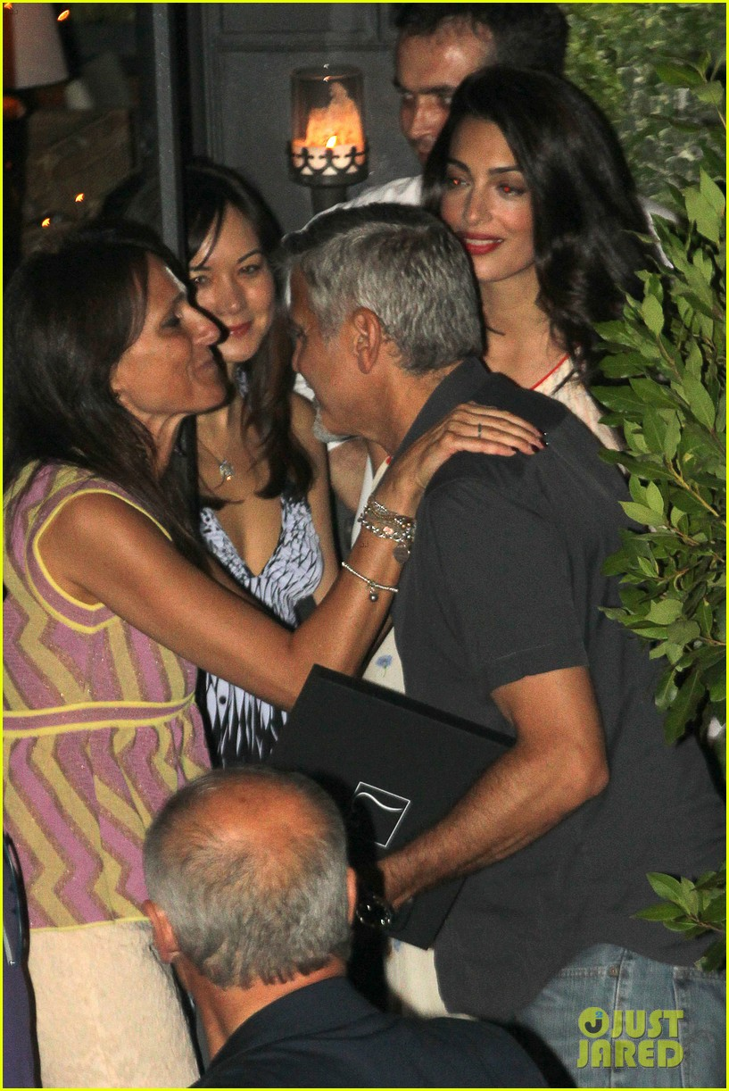 new parents george amal clooney dine with friends in italy 033926366