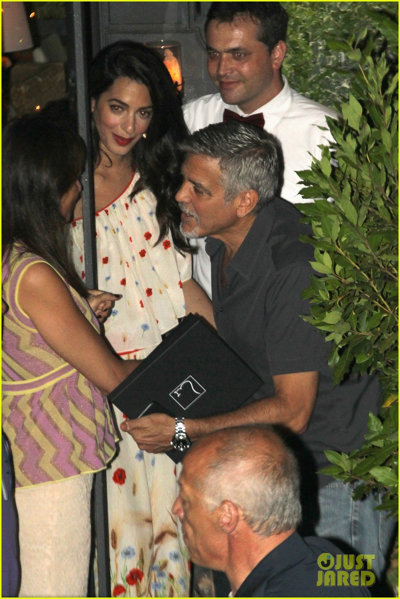 new parents george amal clooney dine with friends in italy 053926368