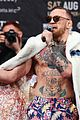conor mcgregor goes shirtless during press conference with floyd mayweather jr 07