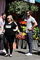 liam hemsworth has a flower for rebel wilson on isnt it romantic set 09