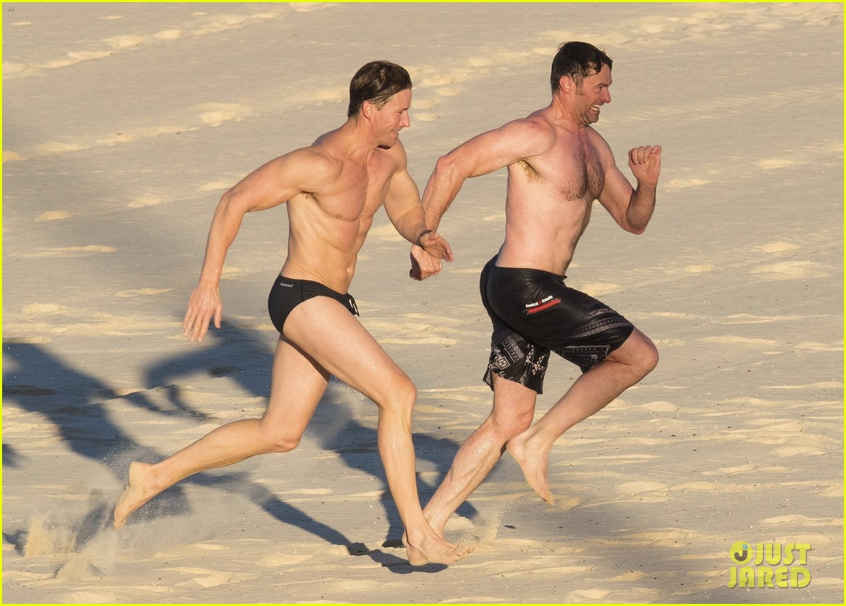hugh jackman hits the beach with his speedo clad trainer 033935320