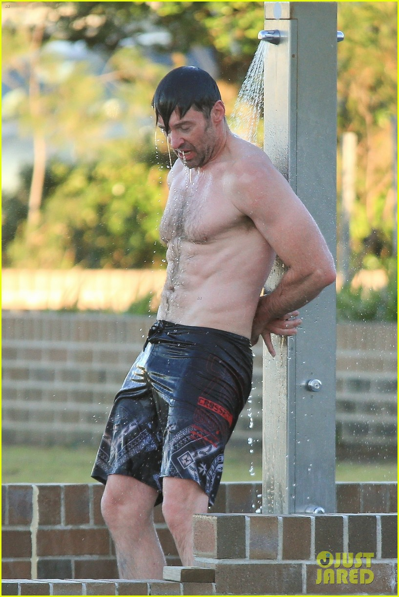 hugh jackman hits the beach with his speedo clad trainer 043935321