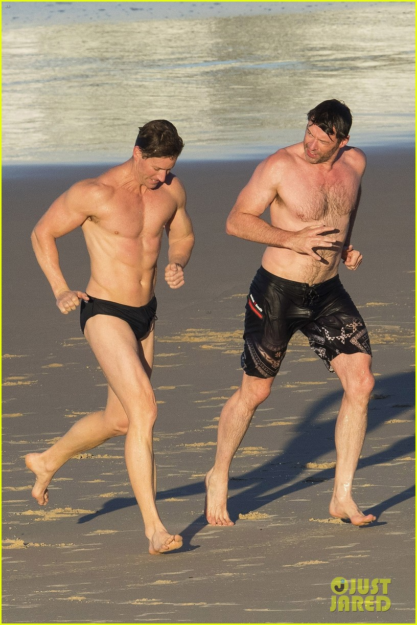 hugh jackman hits the beach with his speedo clad trainer 053935322