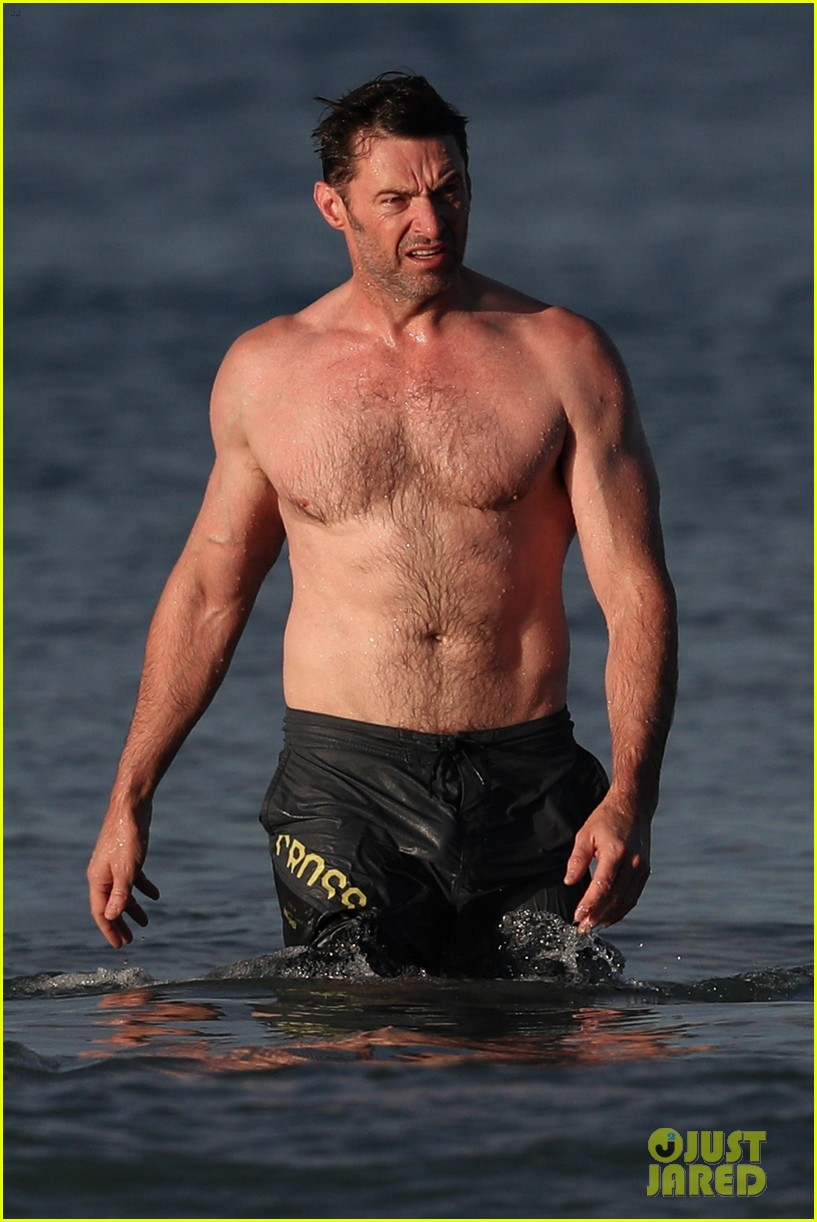 hugh jackman runs shirtless on the beach with his ripped muscles 023935918