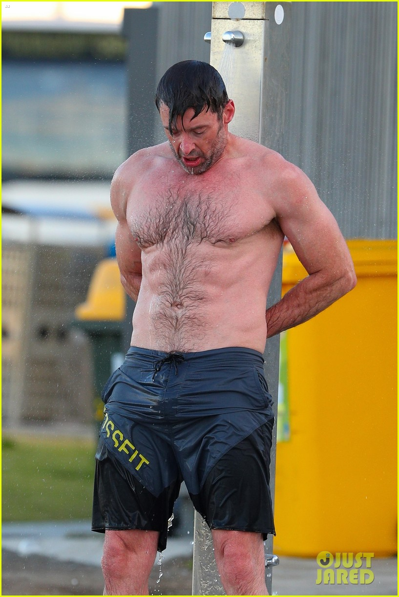 hugh jackman runs shirtless on the beach with his ripped muscles 043935920