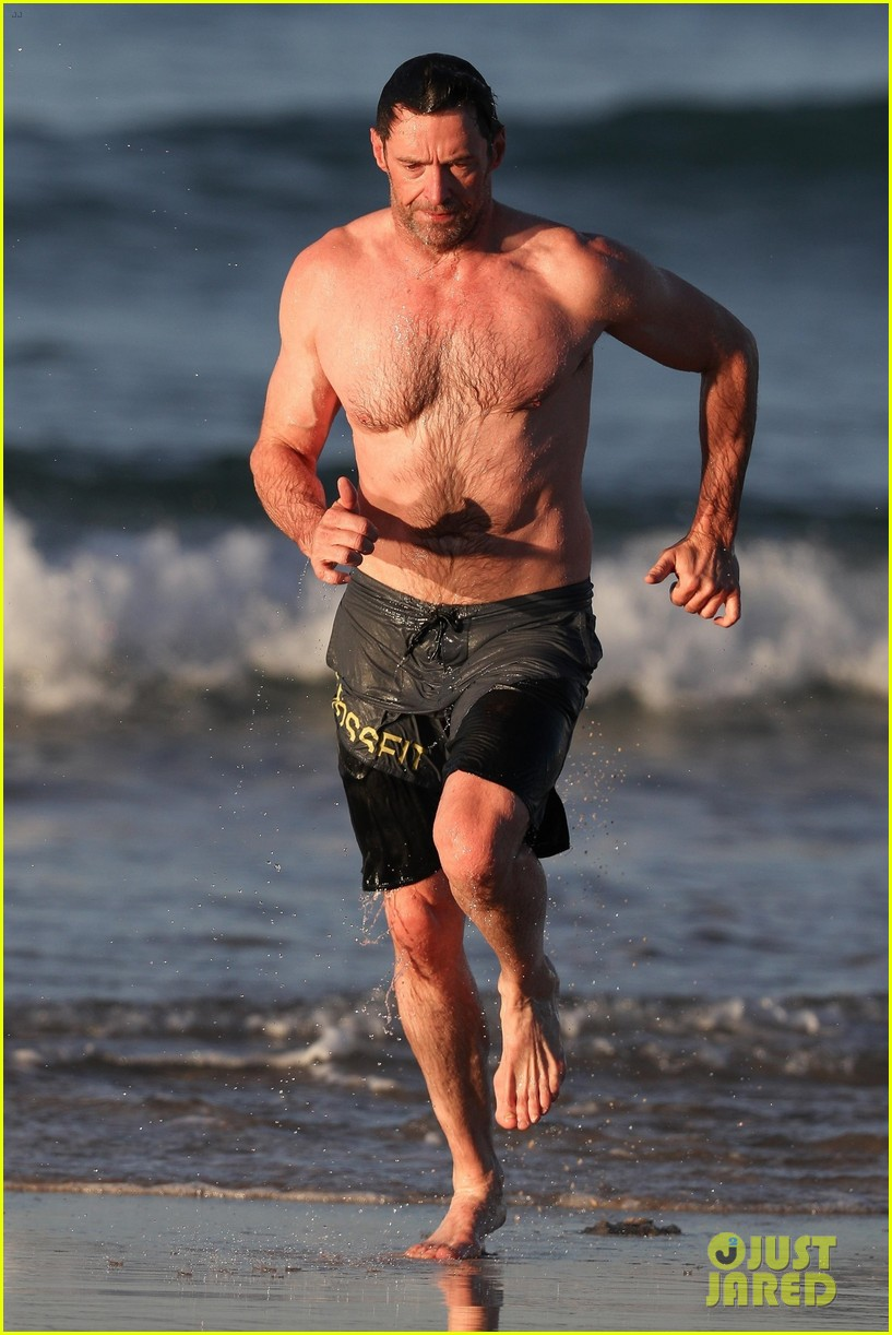 hugh jackman runs shirtless on the beach with his ripped muscles 053935921