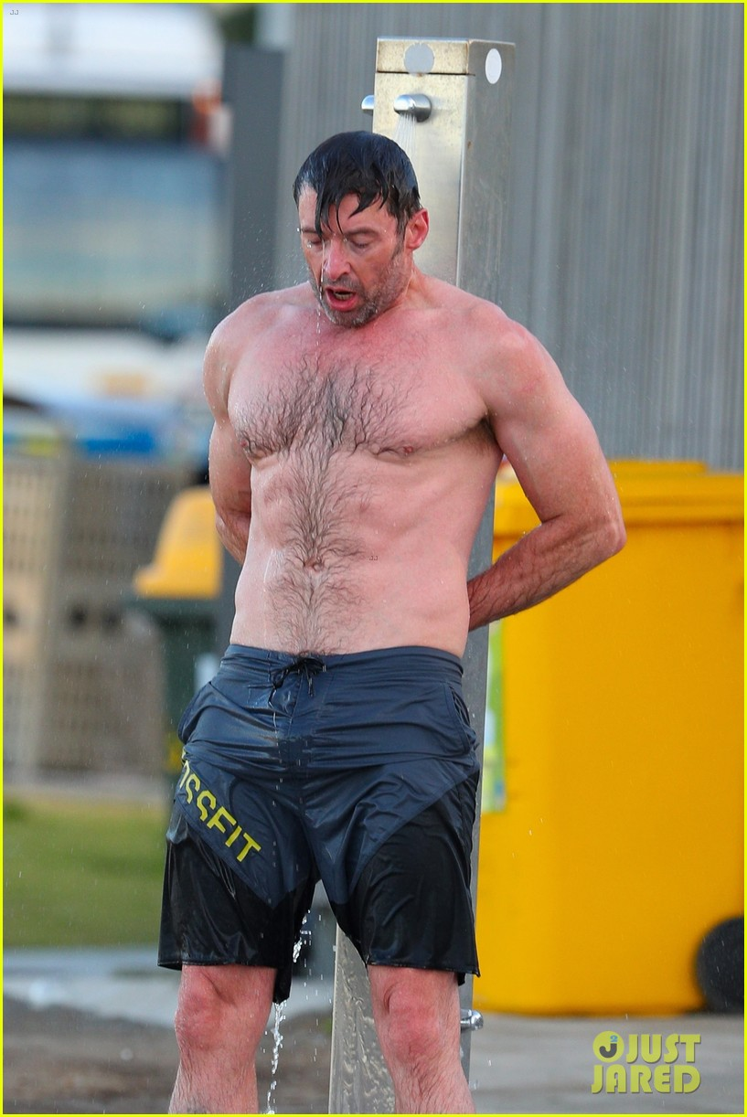 hugh jackman runs shirtless on the beach with his ripped muscles 073935923