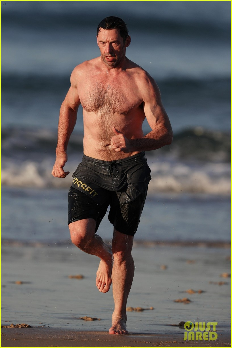 hugh jackman runs shirtless on the beach with his ripped muscles 083935924