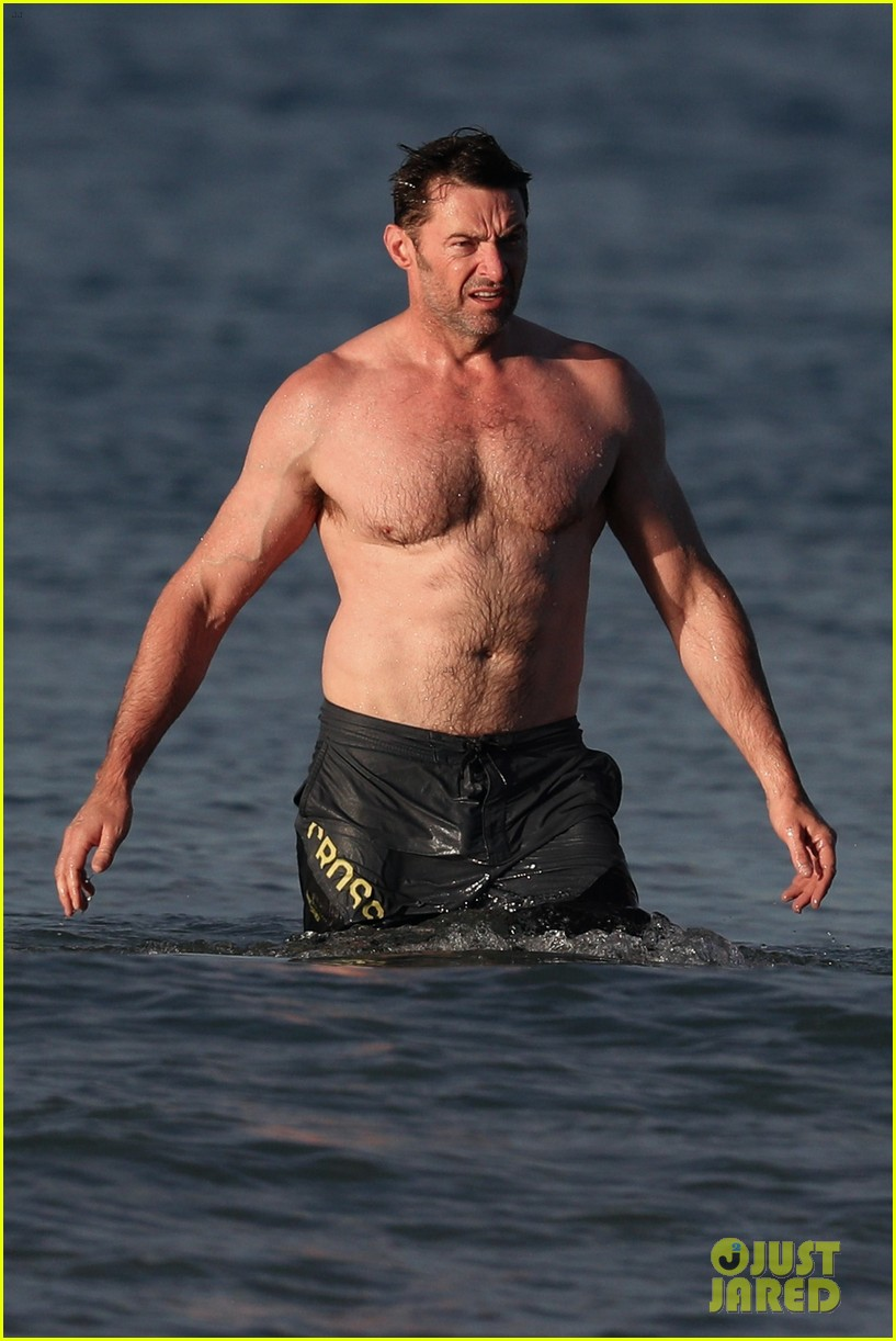 hugh jackman runs shirtless on the beach with his ripped muscles 103935926
