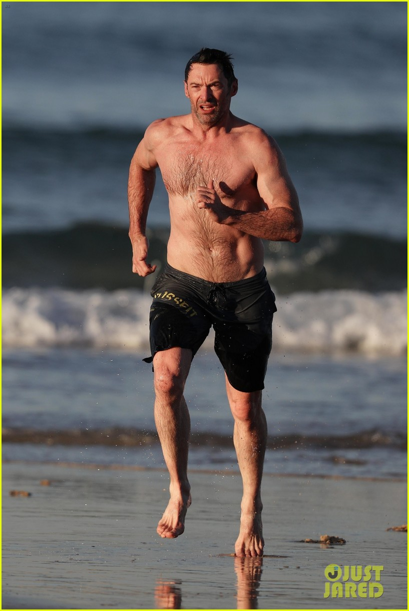 hugh jackman runs shirtless on the beach with his ripped muscles 123935928