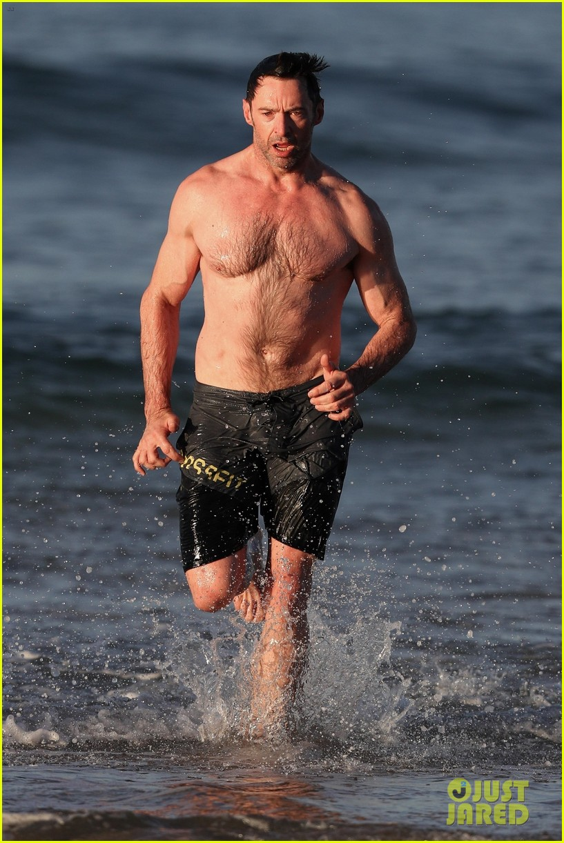 hugh jackman runs shirtless on the beach with his ripped muscles 173935933