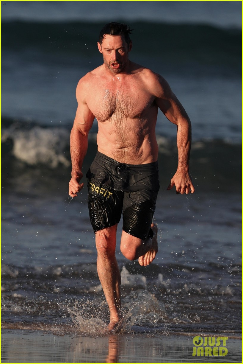 hugh jackman runs shirtless on the beach with his ripped muscles 213935937