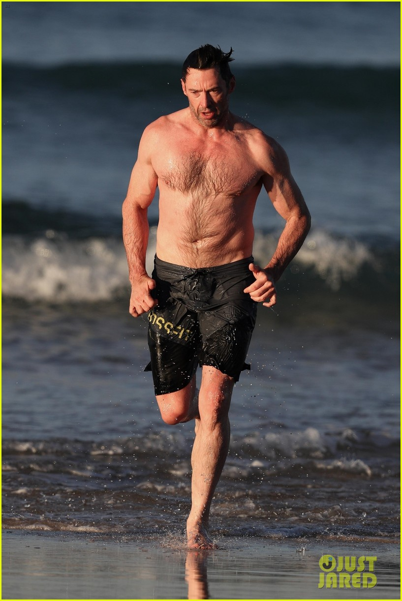 hugh jackman runs shirtless on the beach with his ripped muscles 223935938