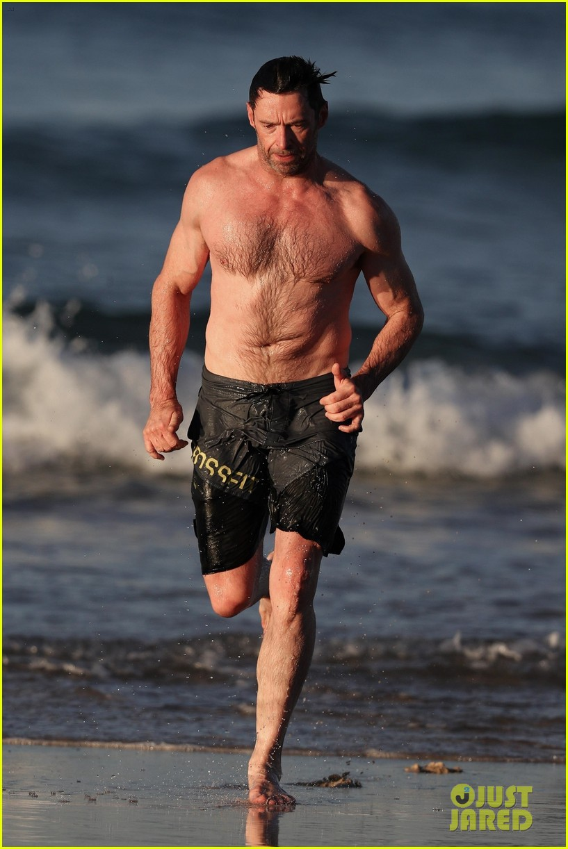 hugh jackman runs shirtless on the beach with his ripped muscles 253935941