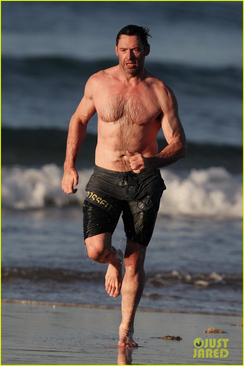 hugh jackman runs shirtless on the beach with his ripped muscles 313935947