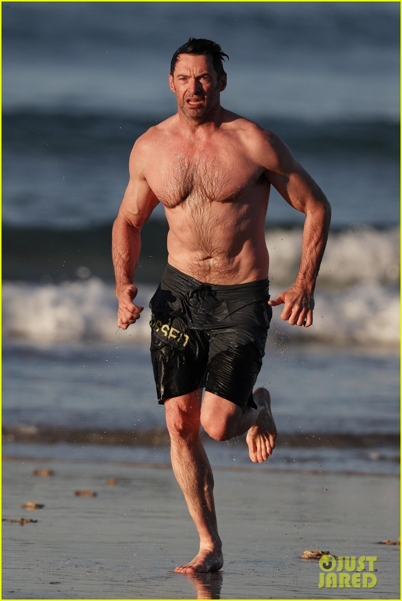 hugh jackman runs shirtless on the beach with his ripped muscles 373935953