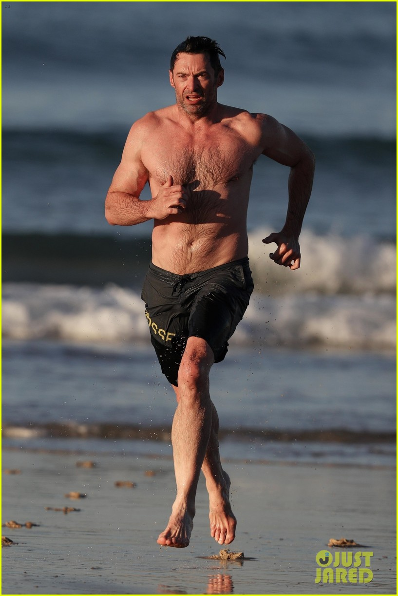 hugh jackman runs shirtless on the beach with his ripped muscles 393935955