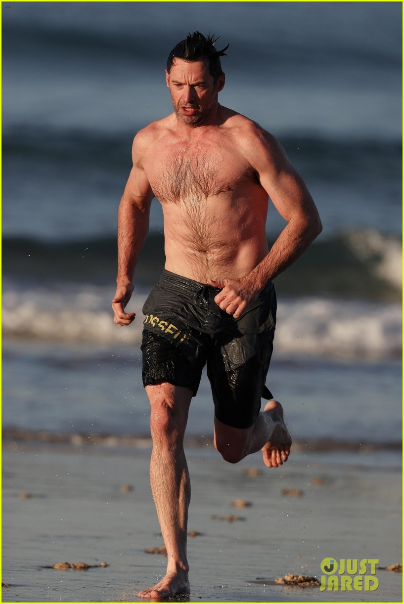 hugh jackman runs shirtless on the beach with his ripped muscles 413935957