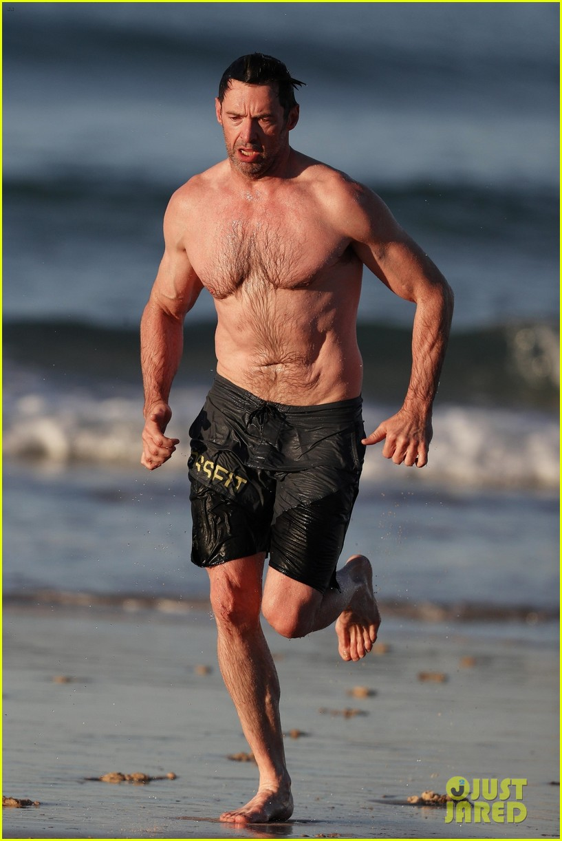 hugh jackman runs shirtless on the beach with his ripped muscles 423935958