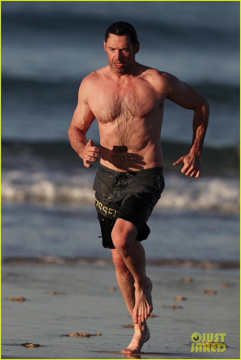 hugh jackman runs shirtless on the beach with his ripped muscles 433935959