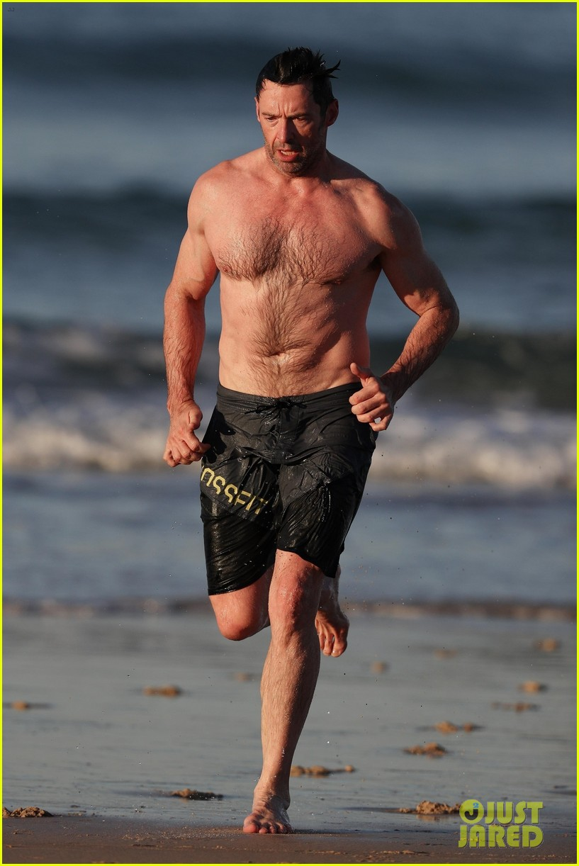 hugh jackman runs shirtless on the beach with his ripped muscles 443935960