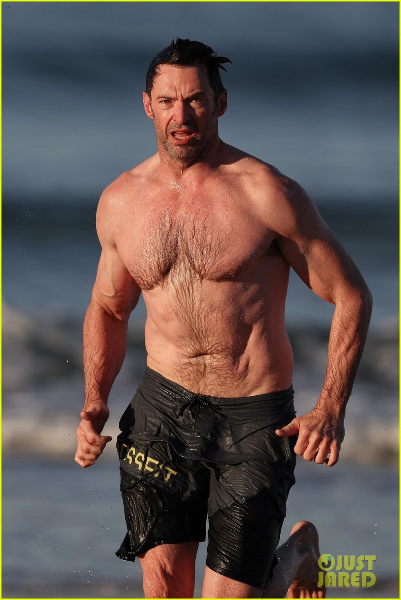 hugh jackman runs shirtless on the beach with his ripped muscles 453935961