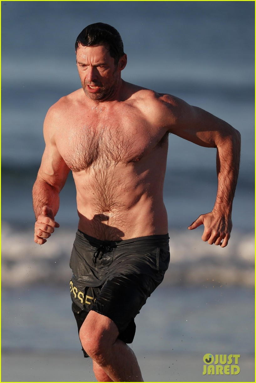 hugh jackman runs shirtless on the beach with his ripped muscles 483935964