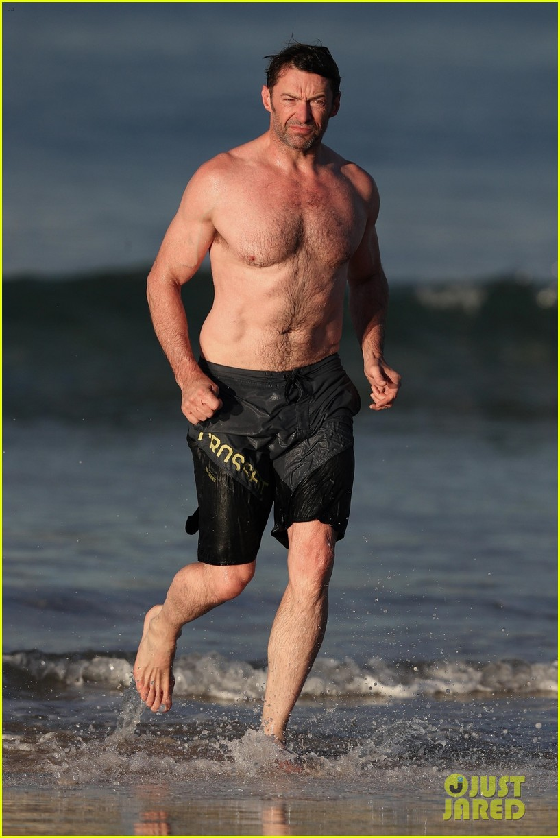 hugh jackman runs shirtless on the beach with his ripped muscles 503935966