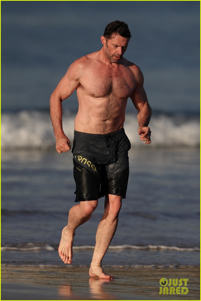 hugh jackman runs shirtless on the beach with his ripped muscles 533935969