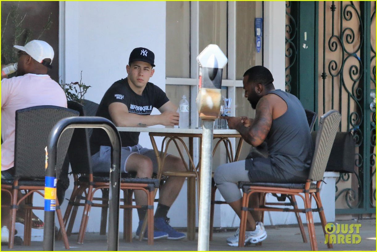nick jonas shows off his buff arm muscles after a workout 053924506