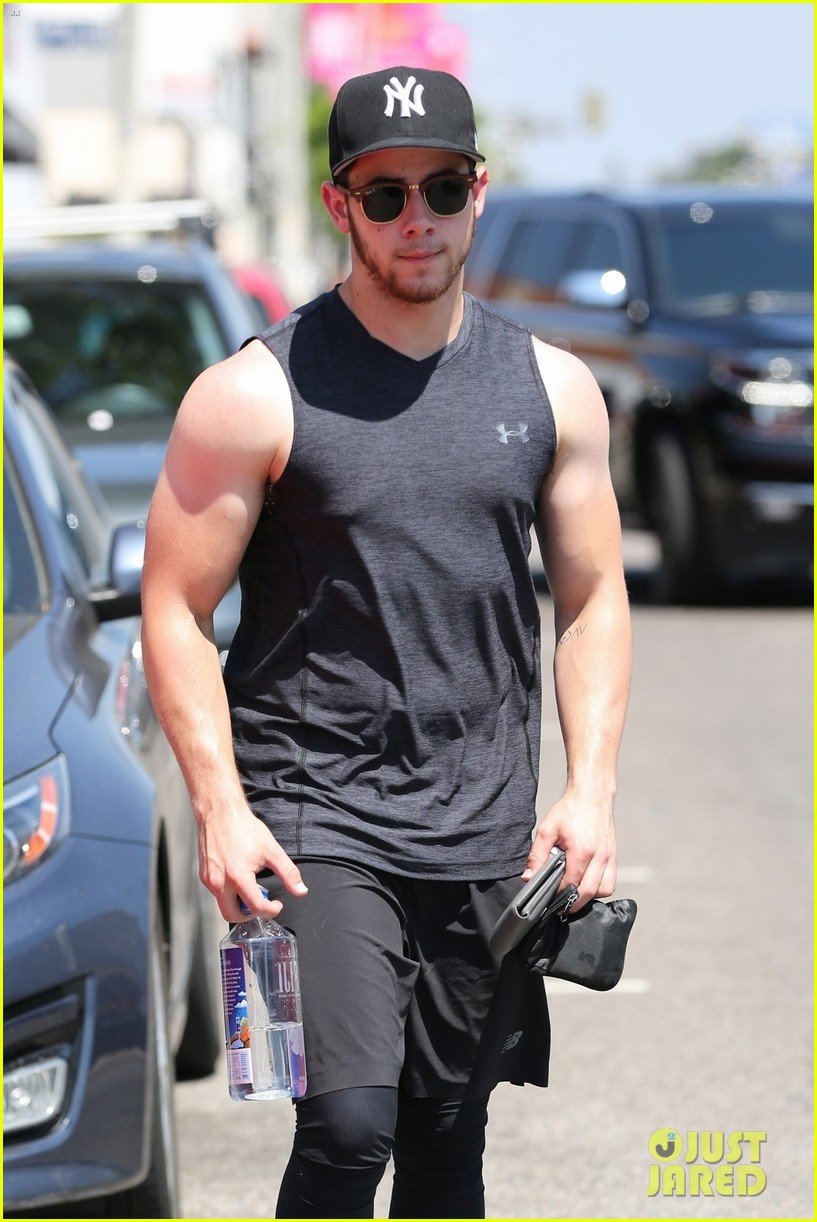 nick jonas bares buff biceps farmers tan after a workout 043936094
