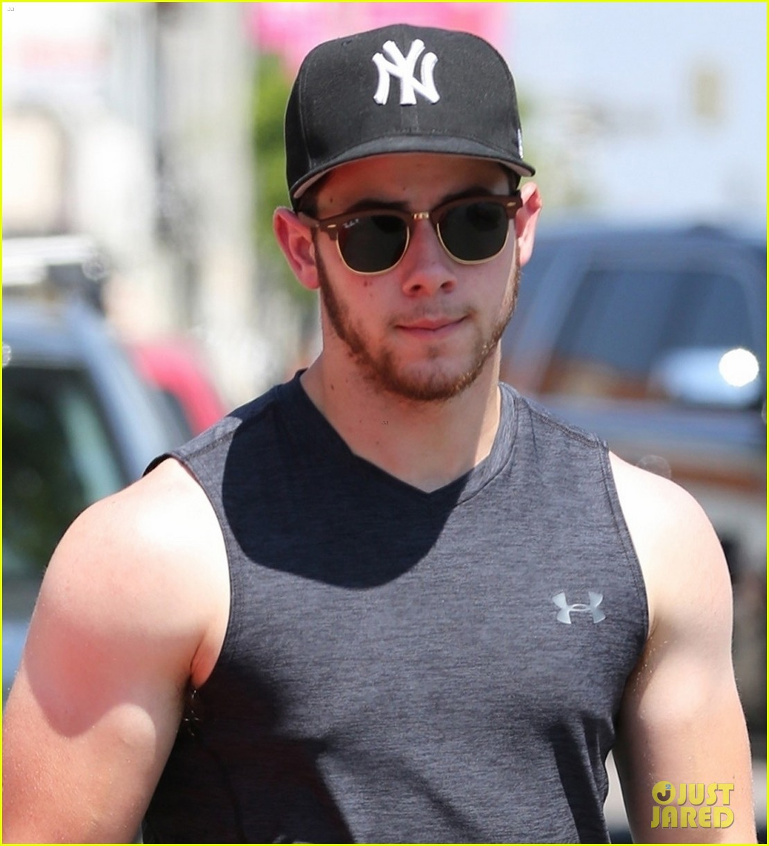 nick jonas bares buff biceps farmers tan after a workout 083936098