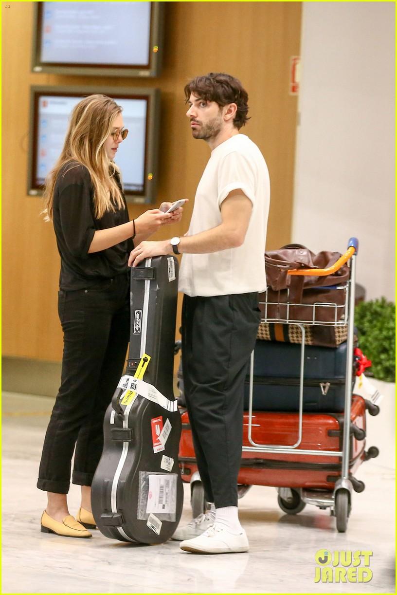 Abby Huntsman Twins >> Elizabeth Olsen's Boyfriend Shares 'Passport to Paris
