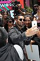 wilmer valderrama poses with a 25 foot puppet version of him 29