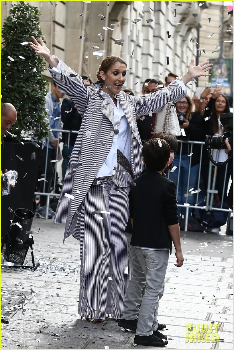celine dion her twins exit their hotel to a confetti shower 053940639