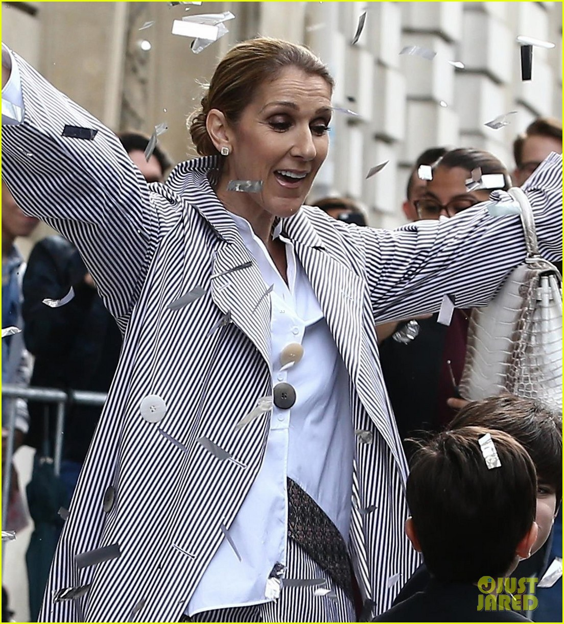 celine dion her twins exit their hotel to a confetti shower 083940642