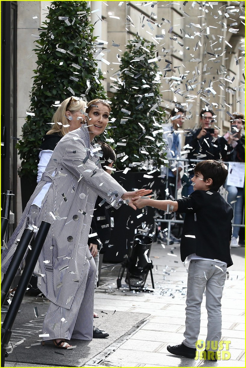 celine dion her twins exit their hotel to a confetti shower 093940643