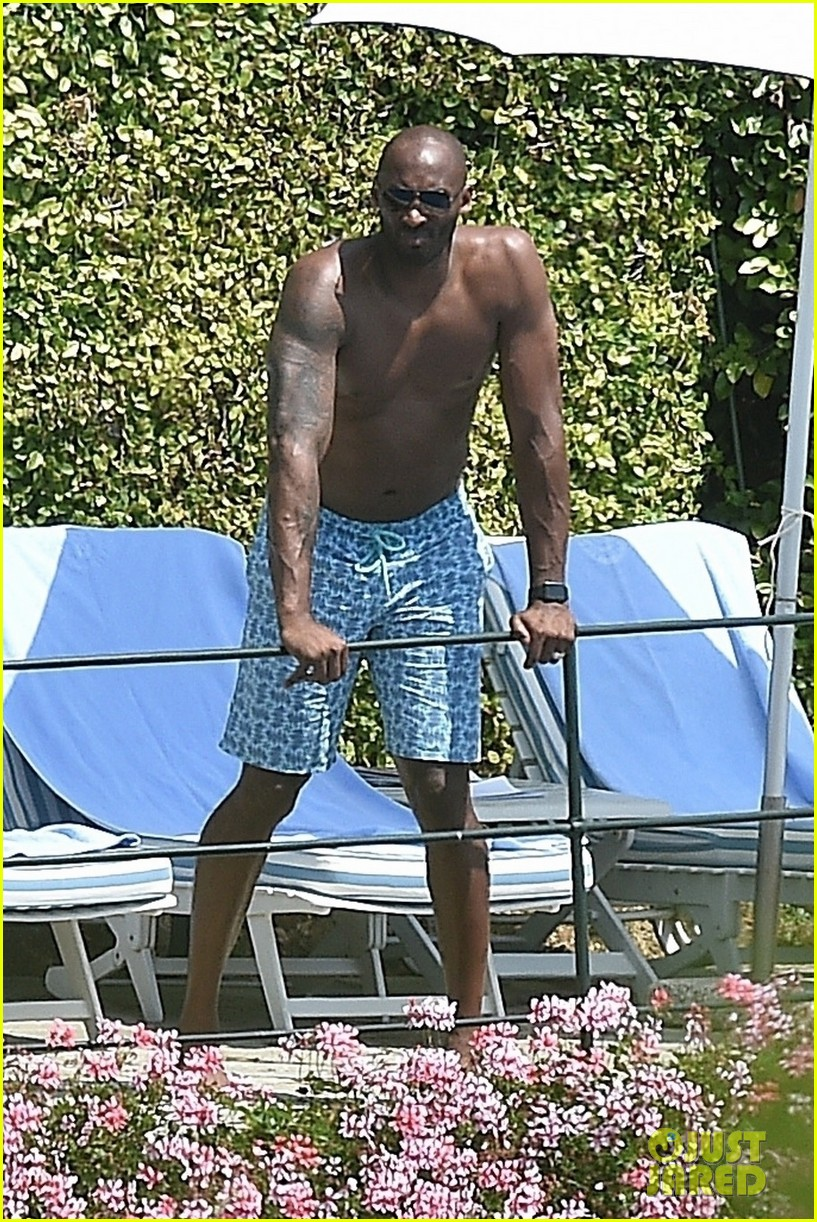 Kobe Bryant Hangs Shirtless By The Pool During Family