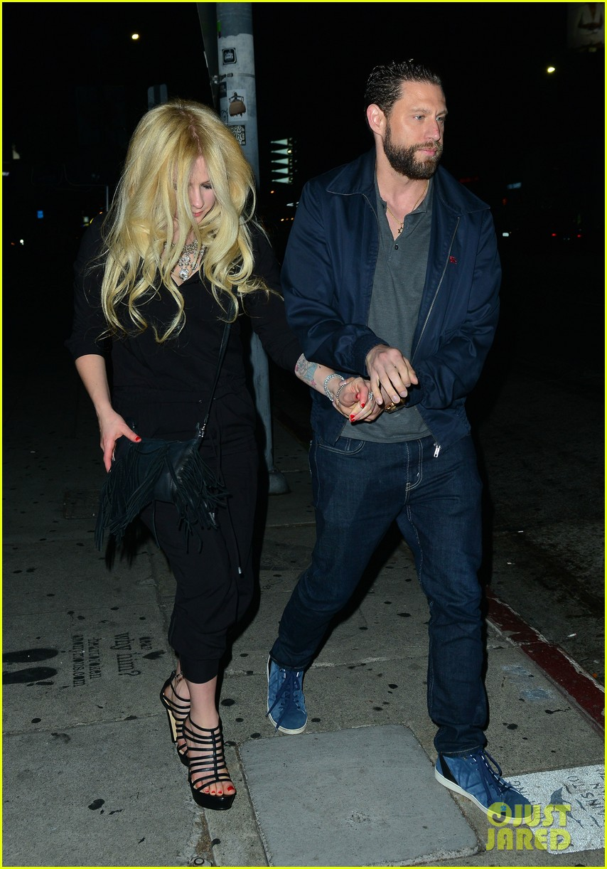 Image result for Avril Lavigne holds hands with her boyfriend, music producer J.R. Rotem