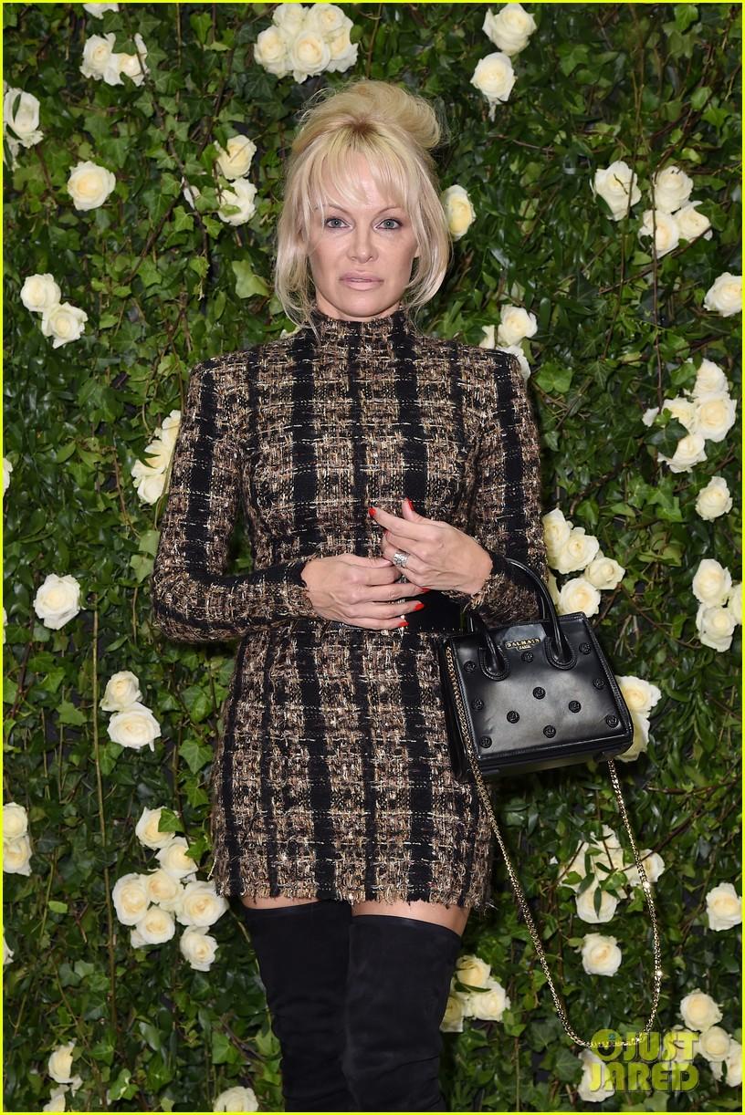pamela anderson steps out for balmain fashion show after mourning hugh hefners death 013965736