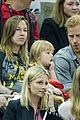 prince harry makes funny faces for a baby at the invictus games 09