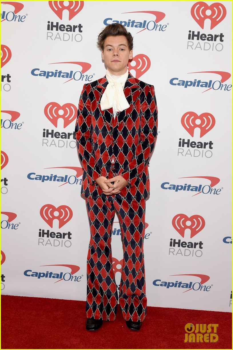 harry styles shows off his signature style at iheartradio