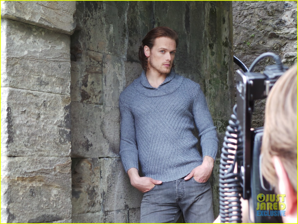 sam-heughan-just-jared-spotlight-behind-