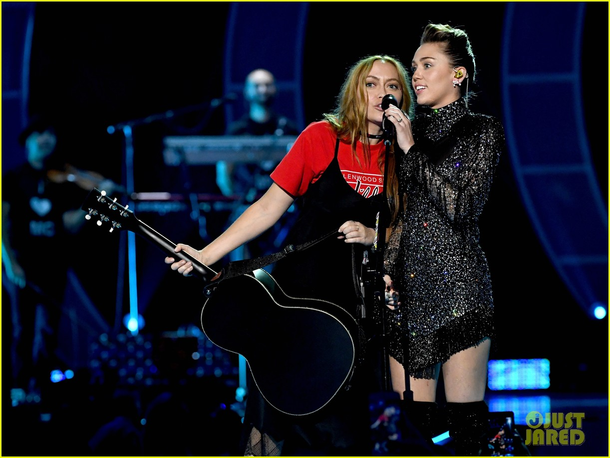 miley cyrus sparkles on stage at iheartradio music festival. 153963206