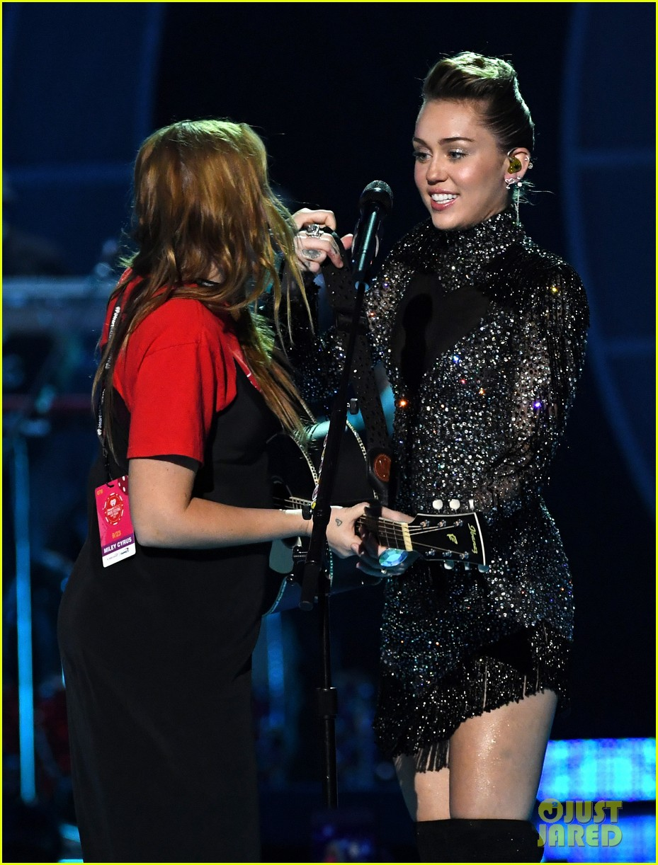 miley cyrus sparkles on stage at iheartradio music festival. 163963207
