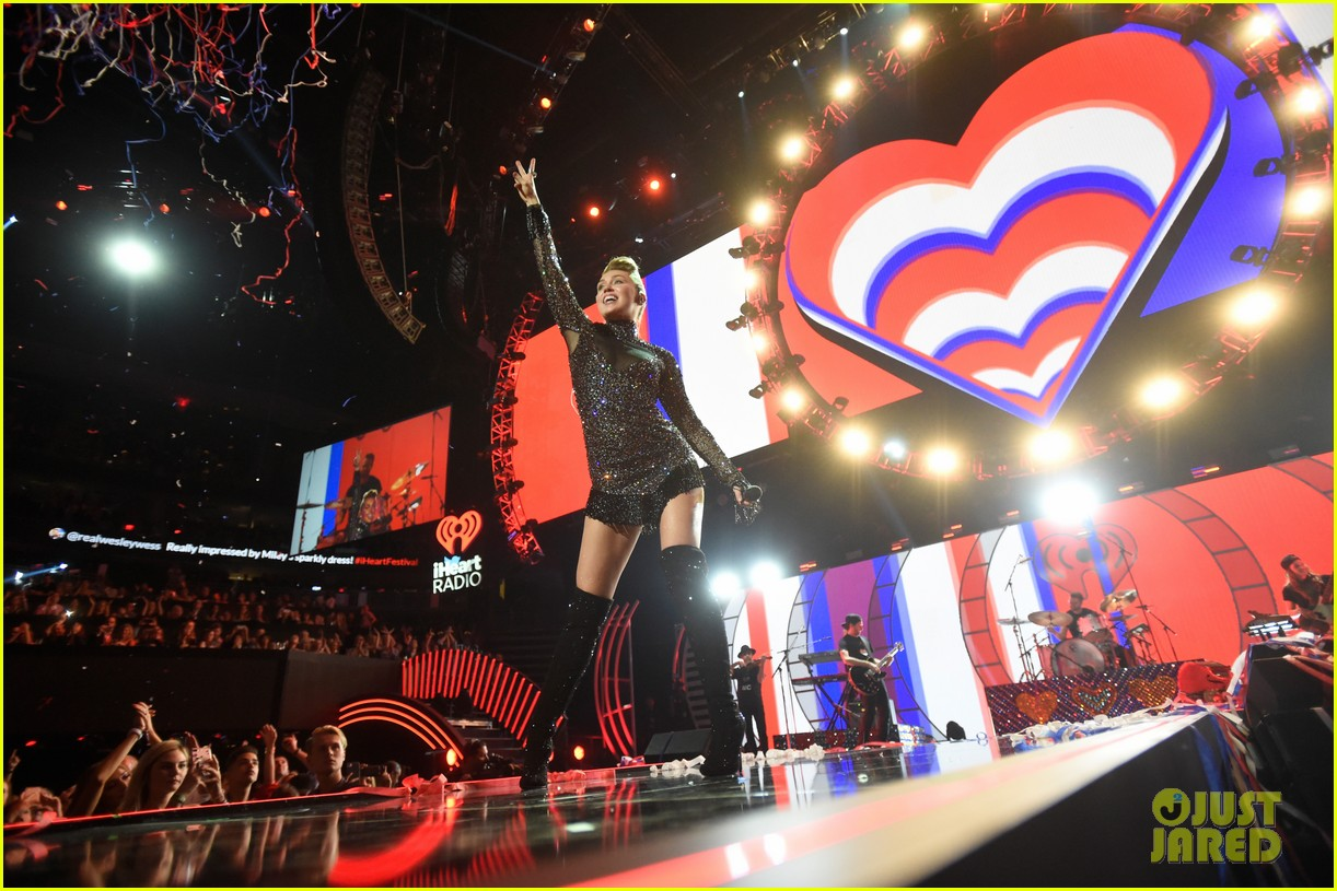 miley cyrus sparkles on stage at iheartradio music festival. 173963208