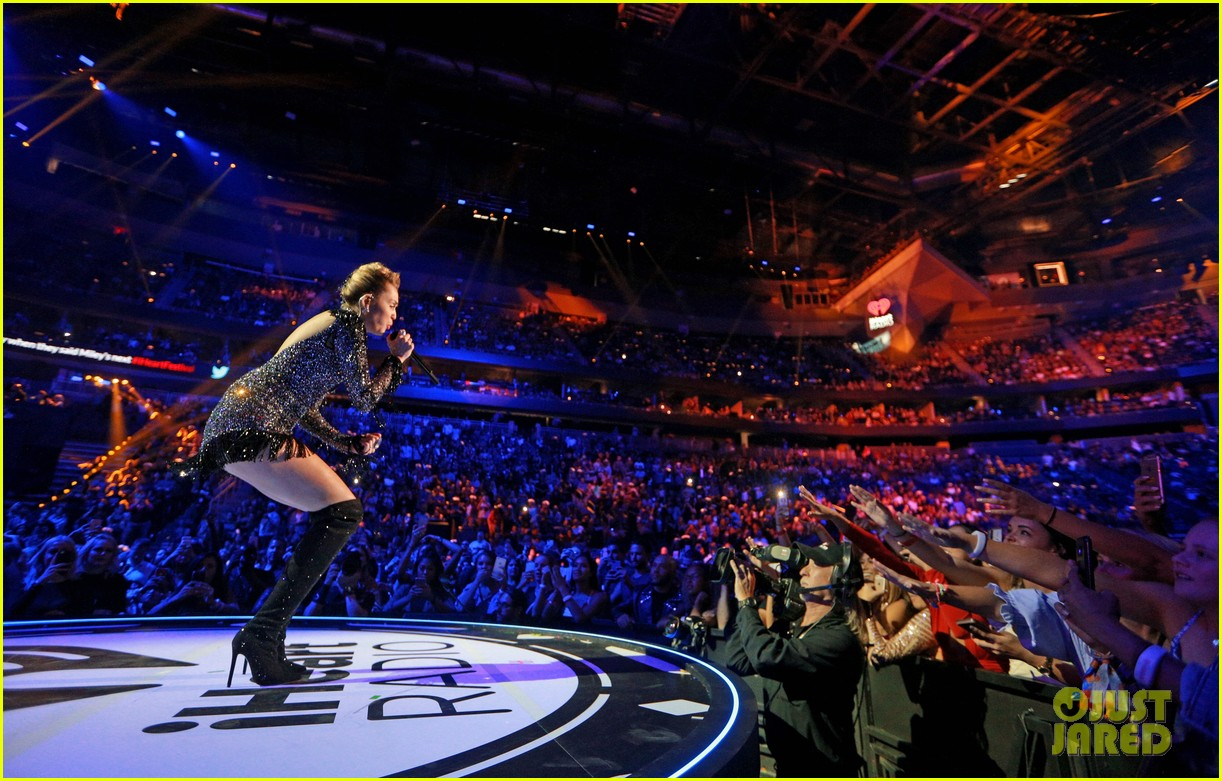 miley cyrus sparkles on stage at iheartradio music festival. 303963221