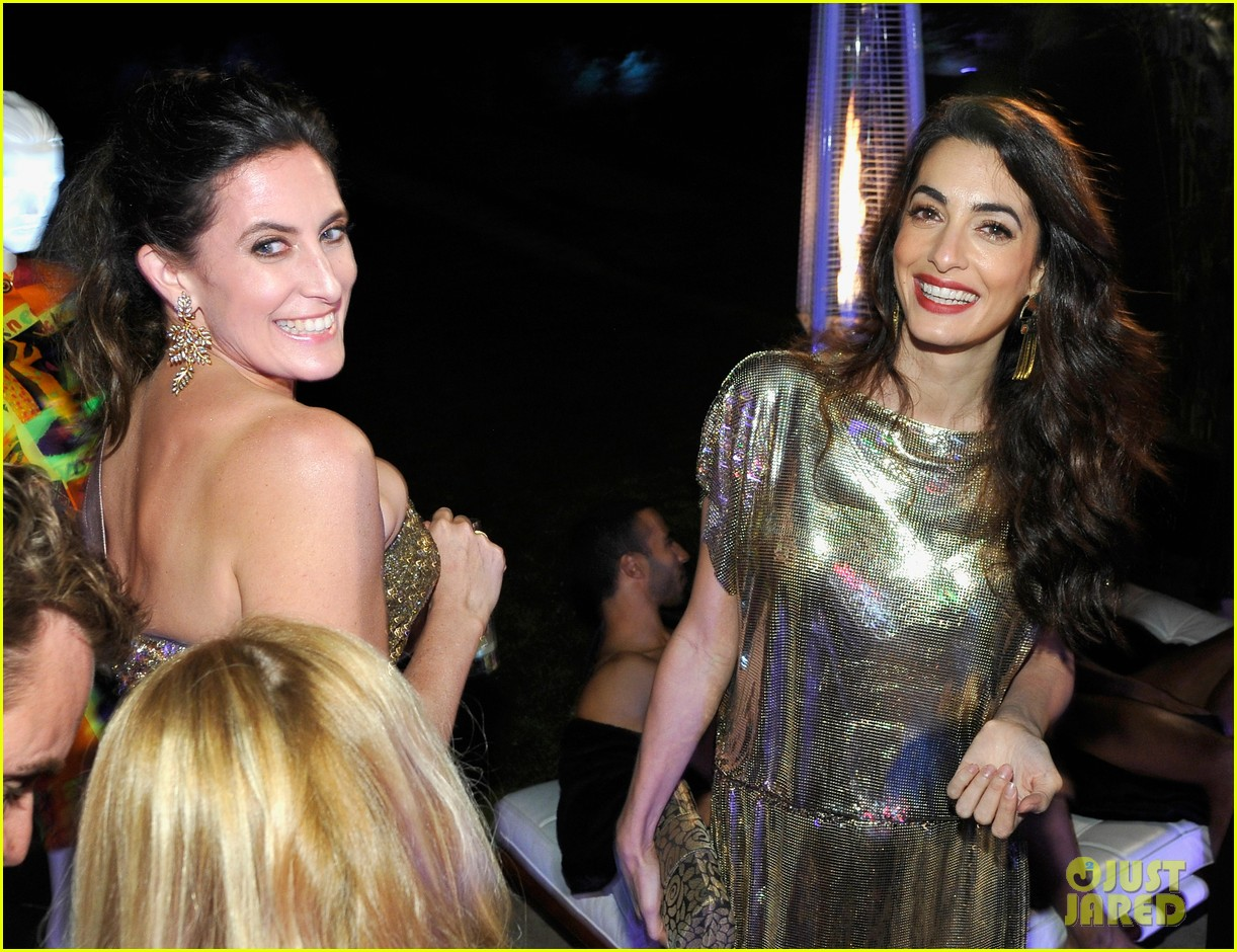 amal clooney has solo girls night out at william vintages gianni versace archive 233968918