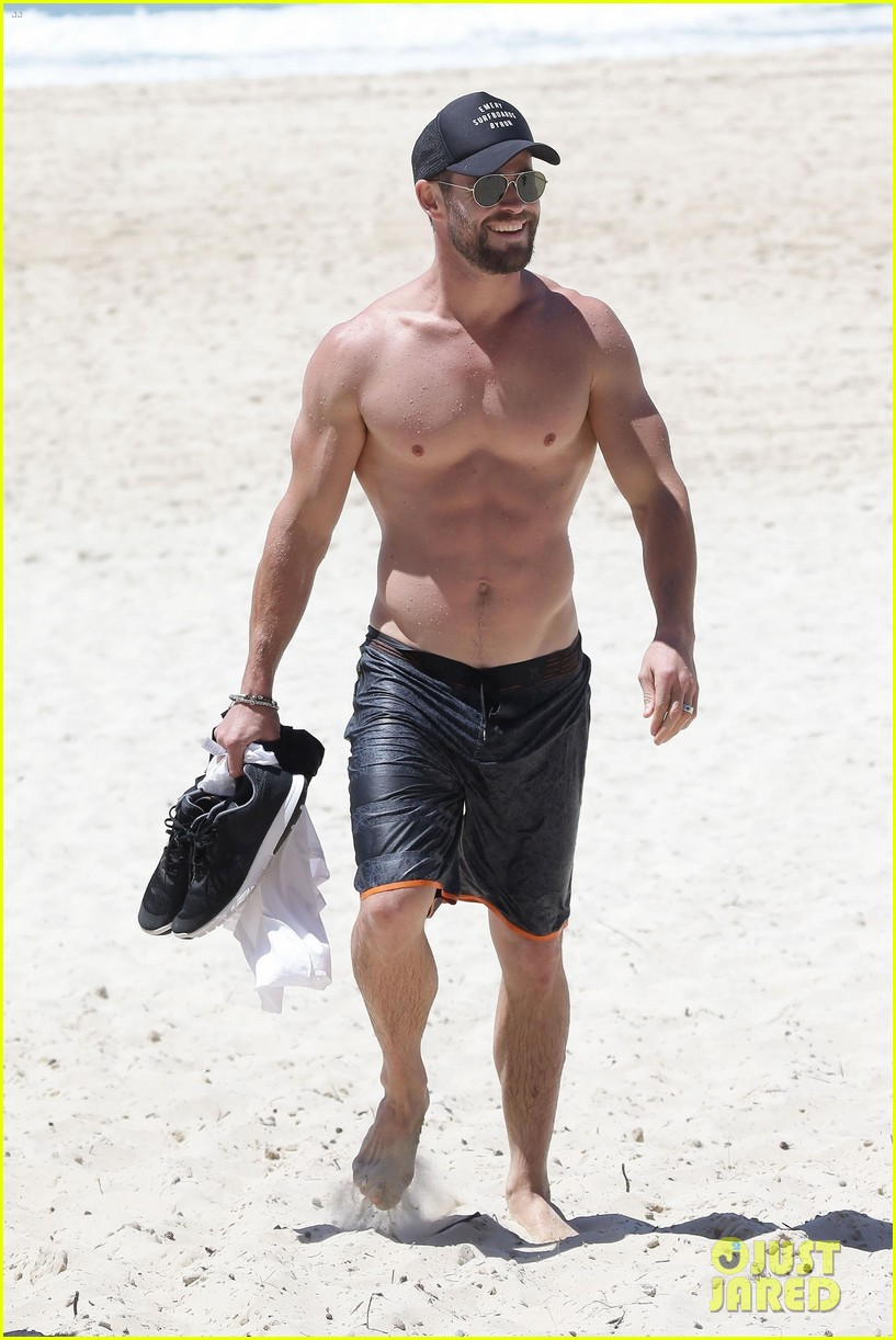 chris hemsworth goes shirtless at beach in australia 053972245