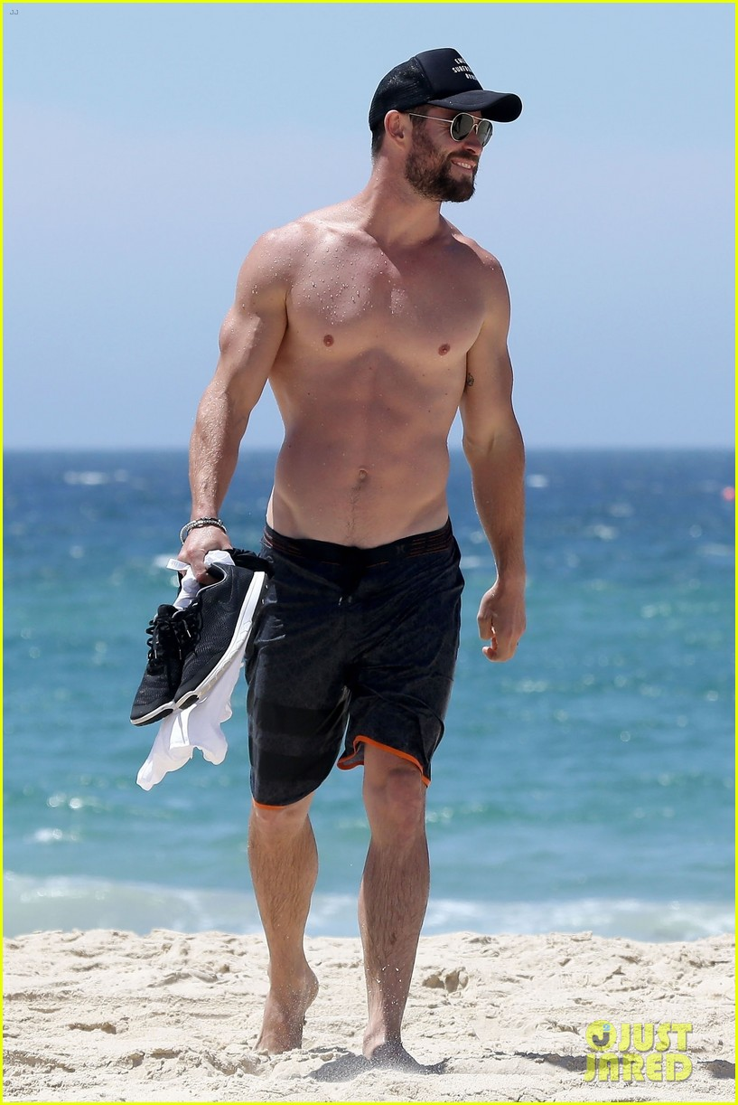 chris hemsworth goes shirtless at beach in australia 063972246